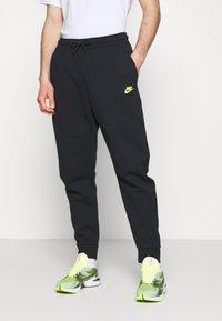 Nike Sportswear - Tracksuit bottoms - black/volt - 0