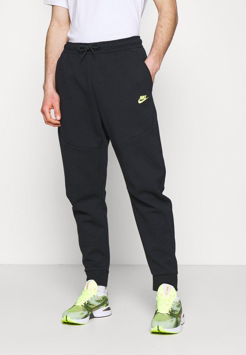 Nike Sportswear - Tracksuit bottoms - black/volt