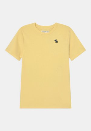 BASICS - Basic T-shirt - yellow solid