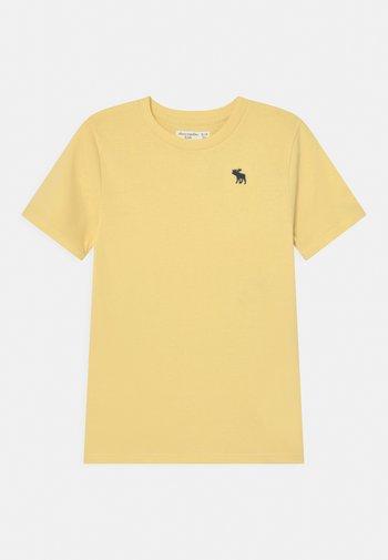 BASICS - T-shirts basic - yellow solid