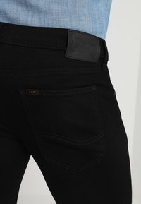 Lee - TRENTON - Straight leg jeans - black rinse - 6