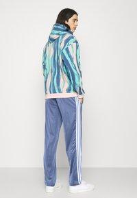 adidas Originals - FIREBIRD UNISEX - Verryttelyhousut - crew blue - 2