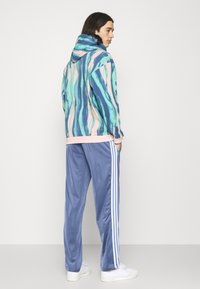 adidas Originals - FIREBIRD UNISEX - Tracksuit bottoms - crew blue - 2