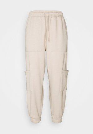 UTILITY JOGGER - Pantalones deportivos - stone