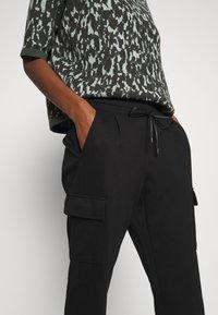 Opus - ELENI - Pantalones - black - 4