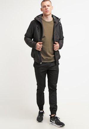 FRICKIN SLIM FIT - Spodnie materiałowe - black