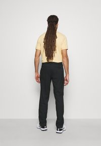 Nike Golf - PANT ESSENTIAL - Kalhoty - black - 2