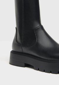Bershka - Kotníkové boty na platformě - black - 5