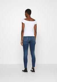 Calvin Klein Jeans - LOGO TRIM BARDOT - Print T-shirt - bright white - 2