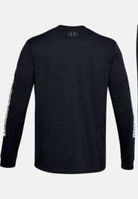Under Armour - Print T-shirt - black - 4