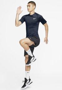 Nike Performance - Basic T-shirt - obsidian/white - 1