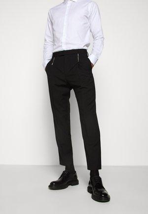 FRITZ - Suit trousers - black