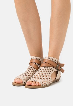 VEGAN BALLA - Ankle cuff sandals - gold draped