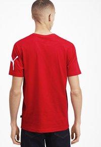 Puma - SHORT SLEEVE - T-shirt imprimé - high risk red - 2