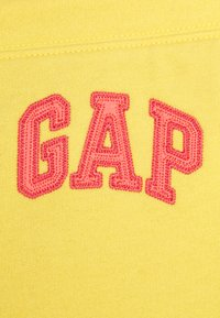 GAP - Tracksuit bottoms - clear yellow - 2