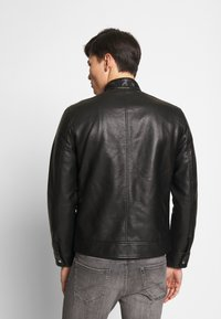 CELIO - RUBIKER - Faux leather jacket - black