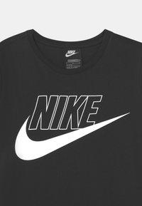 Nike Sportswear - FUTURA  - Jersey dress - black/white - 2