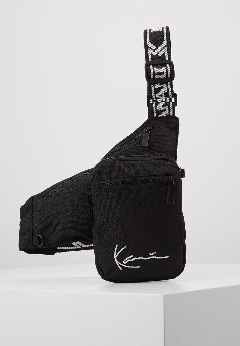 Karl Kani - SIGNATURE TAPE BODY BAG - Bum bag - black/white