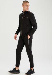 DeFacto Fit - Pantalon de survêtement - black - 1