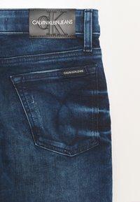 Calvin Klein Jeans - TAPERED - Slim fit jeans - denim - 2
