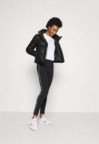 Calvin Klein Jeans - MOTO OUTLINE LOGO MILANO - Legging - black - 1
