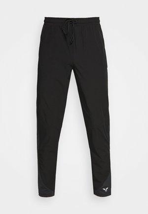 LIMITLESS TRACK PANTS - Pantalon de survêtement - grey