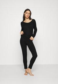 GAP - FOLDOVER  - Pyjama bottoms - true black - 1