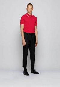 BOSS - Polo shirt - pink - 1