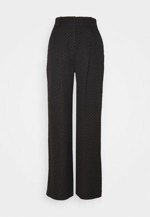 CARRI - Trousers - black