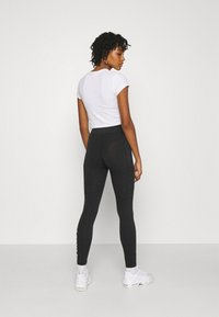 Nike Sportswear - Leggings - Trousers - black/white - 2