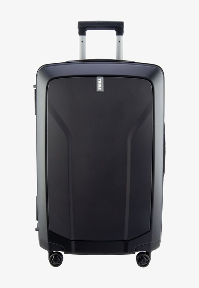 REVOLVE MEDIUM - Wheeled suitcase - black
