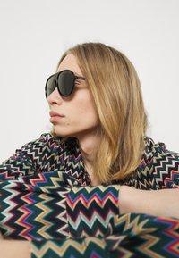 Gucci - Occhiali da sole - black - 1
