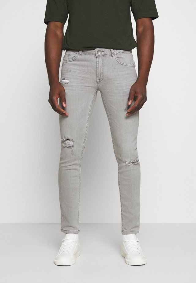 STOCKHOLM DESTROY - Jeansy Skinny Fit - bleach grey