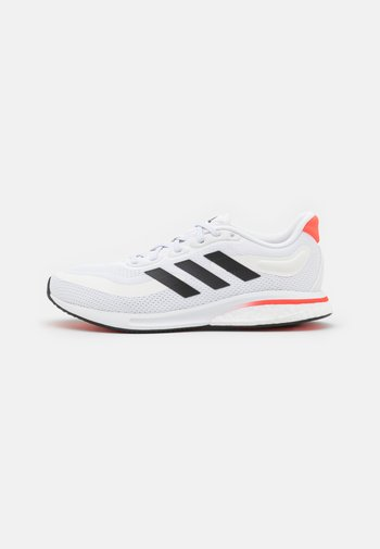 SUPERNOVA RUNNING BOOST BOUNCE PRIMEGREEN SHOES - Neutral running shoes - footwear white/core black/solar red