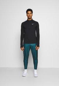 Nike Performance - SHIELD - Pantaloni sportivi - dark teal green/black/silver - 1