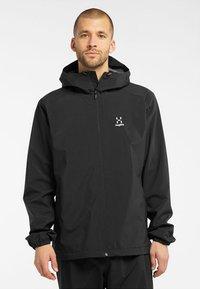 Haglöfs - BUTEO JACKET - Hardshell jacket - true black - 0