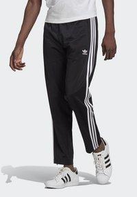 adidas Originals - ADICOLOR CLASSICS FIREBIRD PRIMEBLUE TRACK PANTS - Tracksuit bottoms - black - 0