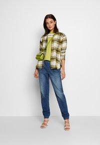 American Eagle - BRANDED SEAMED SANTA MONICA TEE - Print T-shirt - yellow - 1