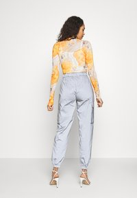 Missguided - CODE CREATEREFLECTIVE JOGGERS - Verryttelyhousut - grey - 3