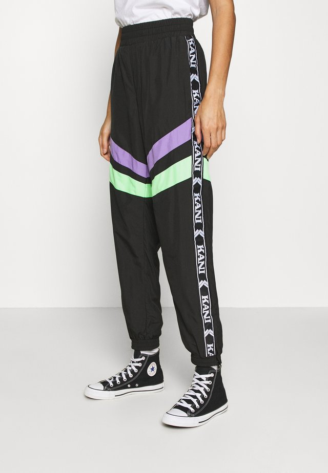 TAPE BLOCK TRACKPANTS  - Verryttelyhousut - black