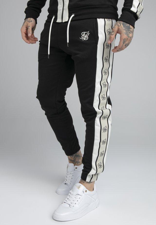 PREMIUM TAPE TRACK PANT - Teplákové kalhoty - jet black/offwhite