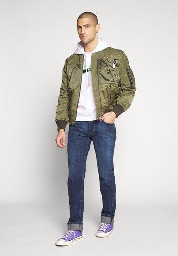 LARKEE - Straight leg jeans - dark-blue denim