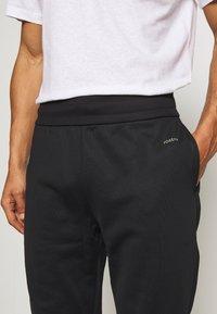 Joseph - NEW NEOPRENE TRACKSUIT - Spodnie treningowe - black - 4