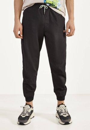 POPELIN - Tracksuit bottoms - black