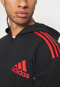 adidas Performance - HOODIE - Zip-up hoodie - black/red - 5