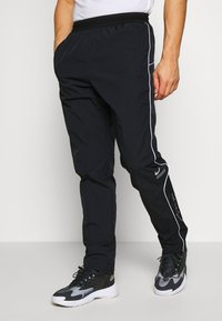 Nike Sportswear - Träningsbyxor - black - 0