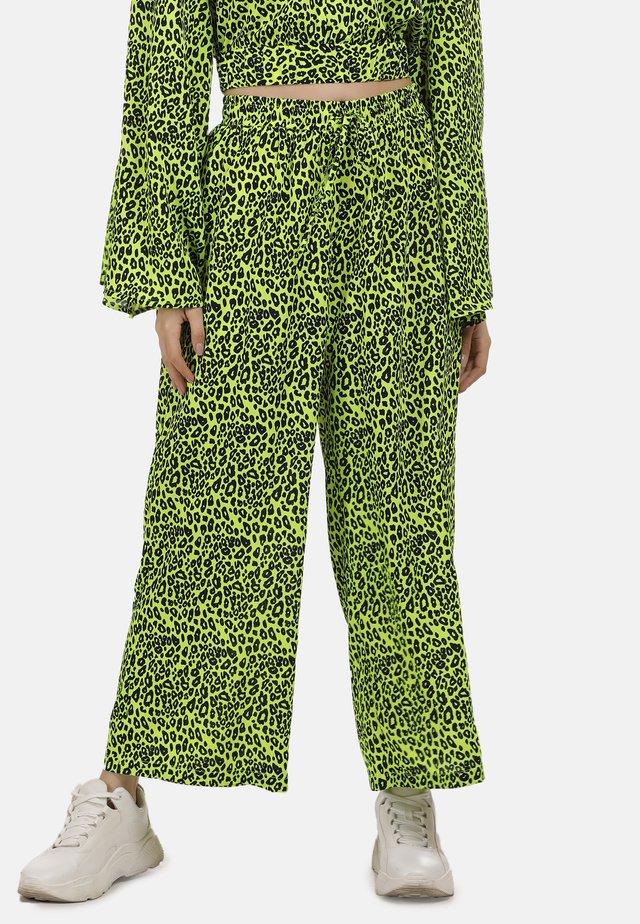 Spodnie materiałowe - neon grün leo