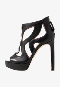 Guess - CABELLS - Platform heels - black - 1