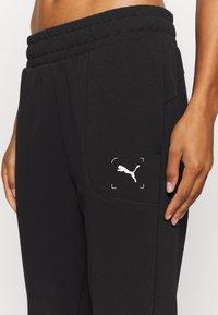 Puma - NU TILITY PANTS - Tracksuit bottoms - black - 4