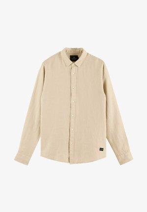 Kostymskjorta - sand